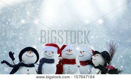 poster of Merry Christmas and happy New Year greeting card with copy-space.Many snowmen standing in winter Chr