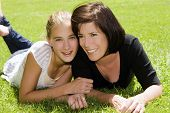 pic of mother daughter  - Mother and daughter outdoors on a Spring day - JPG