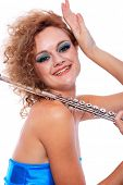foto of transverse  - Portrait of a woman playing transverse flute - JPG