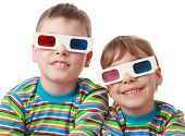 little brother and sister in striped shirt and anaglyph glasses smiling, focus on boy