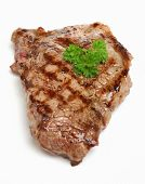 Chargrilled sirloin beef steak with seasoning.