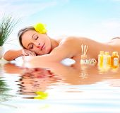 stock photo of spa massage  - Beautiful young woman getting spa massage - JPG