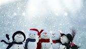 Merry Christmas and happy New Year greeting card with copy-space.Many snowmen standing in winter Chr poster