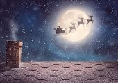 Постер, плакат: Merry Christmas and happy holidays Santa Claus flying in his sleigh on background moon sky Christm