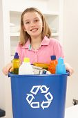 Girl Holding Recyling Waste Bin At Home