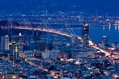 San Francisco Bay Bridge at night aerial view from Twin Peaks.