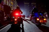 picture of anti-terrorism  - Two Police Officers On Motorcycles In A Night City - JPG