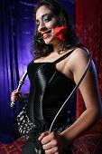 pic of spanking  - Beautiful girl with whip in hands and red rose in mouth - JPG