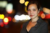 Portrait of a beautiful Asian young woman at night. Shallow DOF.