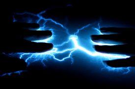 foto of lightning bolt  - Two hands connected via a storm of blue lightning forks - JPG