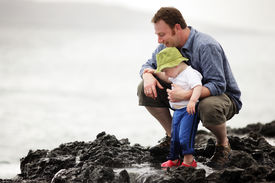 image of father child  - Young father with little son outdoors at ocean - JPG