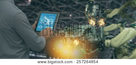 poster of Iot Industry 4.0 Concept,industrial Engineer Using Software (augmented, Virtual Reality) In Tablet T