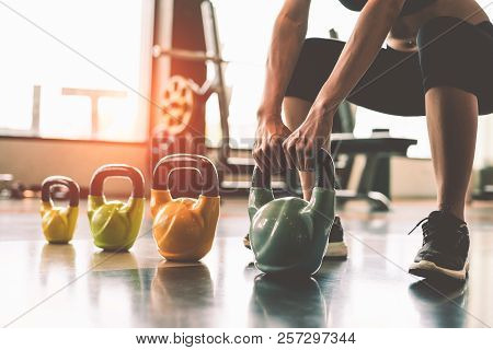 poster of Close Up Of Woman Lifting Kettlebell Like Dumbbells In Fitness Sport Club Gym Training Center With S