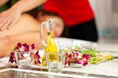 Wellness - woman getting massage in Spa; it is a traditional back massage, focus on massage oil in f