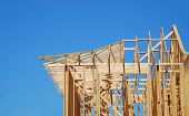 stock photo of 2x4  - New Home Construction Under Blue Sky - JPG