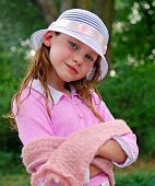 stock photo of prissy  - Young Girl Wearing Nice Hat and Scarf - JPG