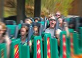 Man Screaming on Fast Roller Coaster with zoom blur