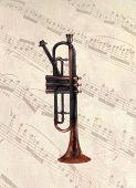 Aged bugle on aged music background