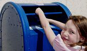 Cute girl mailing letter