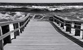 Pier leading to rough surf in ocean