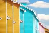 Colorful tropical townhomes under pretty sky