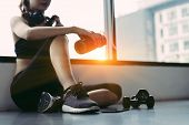 Woman Exercise Workout In Gym Fitness Breaking Relax Holding Protein Shake Bottle After Training Spo poster