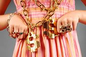 stock photo of gangsta  - Young girl wearing gaudy hip hop jewelry - JPG