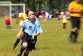 Young girl playing soccer on little league team