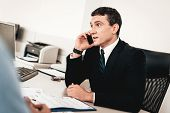 Car Dealer Speaks On Phone In Automobile Salon. Professional Dialogue. Cheerful Customer. Automobile poster