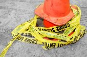 pile of crime scene tape around cone