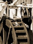 water wheel powering vintage grist mill