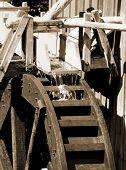 water wheel powering vintage grist mill