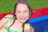 Young girl having fun outdoors during water play