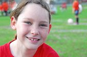 young tomboy girl soccer player on field