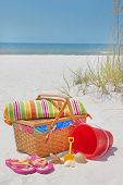 Beach accessories on sand at beautiful seashore