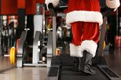 Authentic Santa Claus Training On Treadmill In Modern Gym, Focus On Legs poster