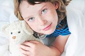 foto of goodnight  - Young girl looking happy in comfortable bed - JPG