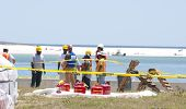 GULF SHORES - MAY 8: Workers gather on May 8, 2010 to protect beautiful Gulf Shores, Alabama from th