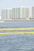 ORANGE BEACH, AL - JUNE 8: Protective oil boom is placed in front of resorts on June 8, 2010 in Perdido Pass in Orange Beach, AL as the BP oil slick threatens wildlife and tourism in the area .