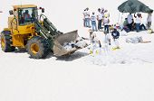PENSACOLA BEACH - JUNE 23:  BP oil workers and heavy machinery work to remove oil covered sand on Ju