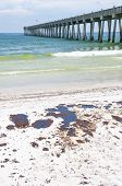 PENSACOLA BEACH - JUNE 23:  Oil covered sand is shown on June 23, 2010 in Pensacola Beach, FL.