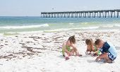 PENSACOLA BEACH - 23 JUNE: Unidentified young children play with sand near oil patches on June 23, 2010 in Pensacola Beach, FL.