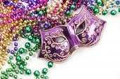 pic of mardi gras mask  - Mardi gras mask and beads in pile - JPG