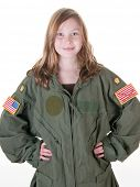 young girl wearing flight suit too big for her as part of her dream to fly