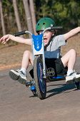 young boy having fun on trike