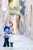 Brother and sister hugging and posing at narrow street in Dubrovnik Croatia