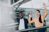 Two Happy Business Companions Rejoicing At Achievements poster