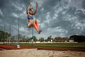 Female Athlete Performing A Long Jump During A Competition At Stadium. The Jump, Athlete, Action, Mo poster