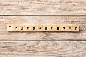 Transparency Word Written On Wood Block. Transparency Text On Table, Concept. poster