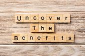 Uncover The Benefits Word Written On Wood Block. Uncover The Benefits Text On Table, Concept. poster